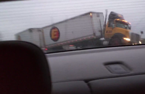truck on black ice barely misses car
