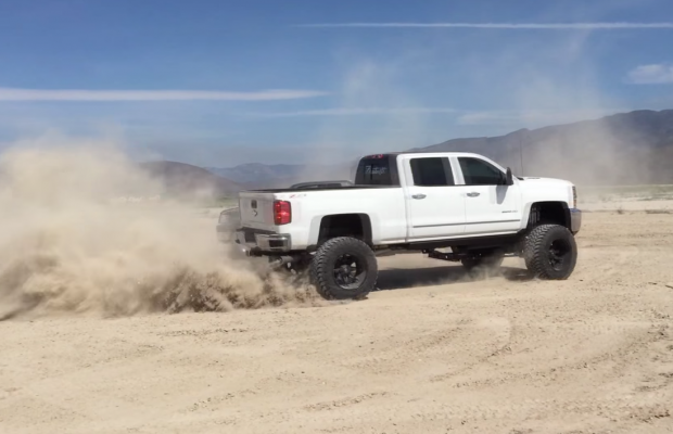 "2015 Chevy Silverado Lifted >> Huge 12"" Lifted Duramax Does Donuts Around A Ford - Black Smoke Media"