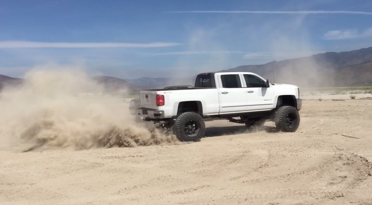 """Huge 12"""" Lifted Duramax Does Donuts Around A Ford - Black ..."""