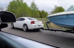 cummins charger pulling a boat