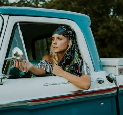woman driving a pick up truck with the best roll up tonneau cover