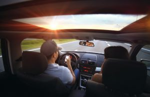 Man using smartphone while driving