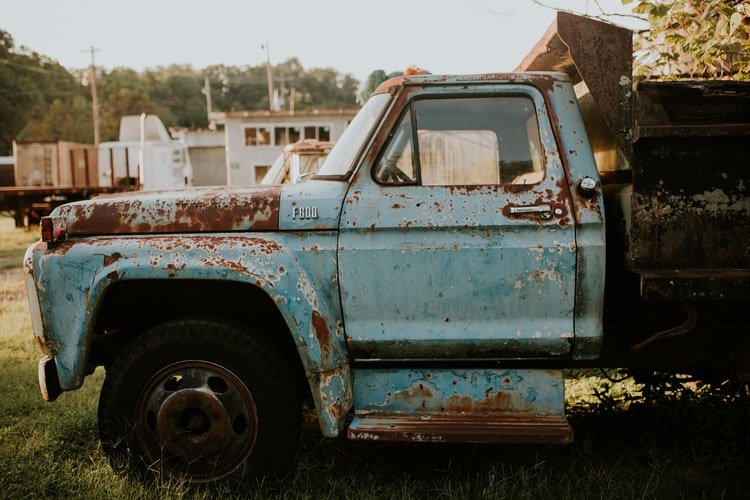 closed blue pick up truck door