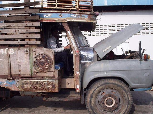 Truck with an opened hood